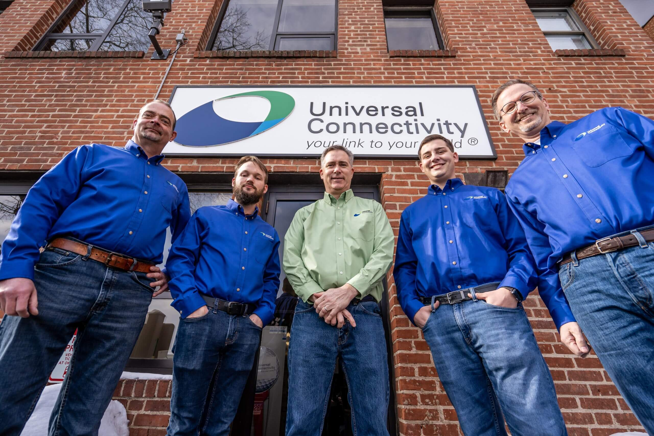 Universal Connectivity team members outside of building