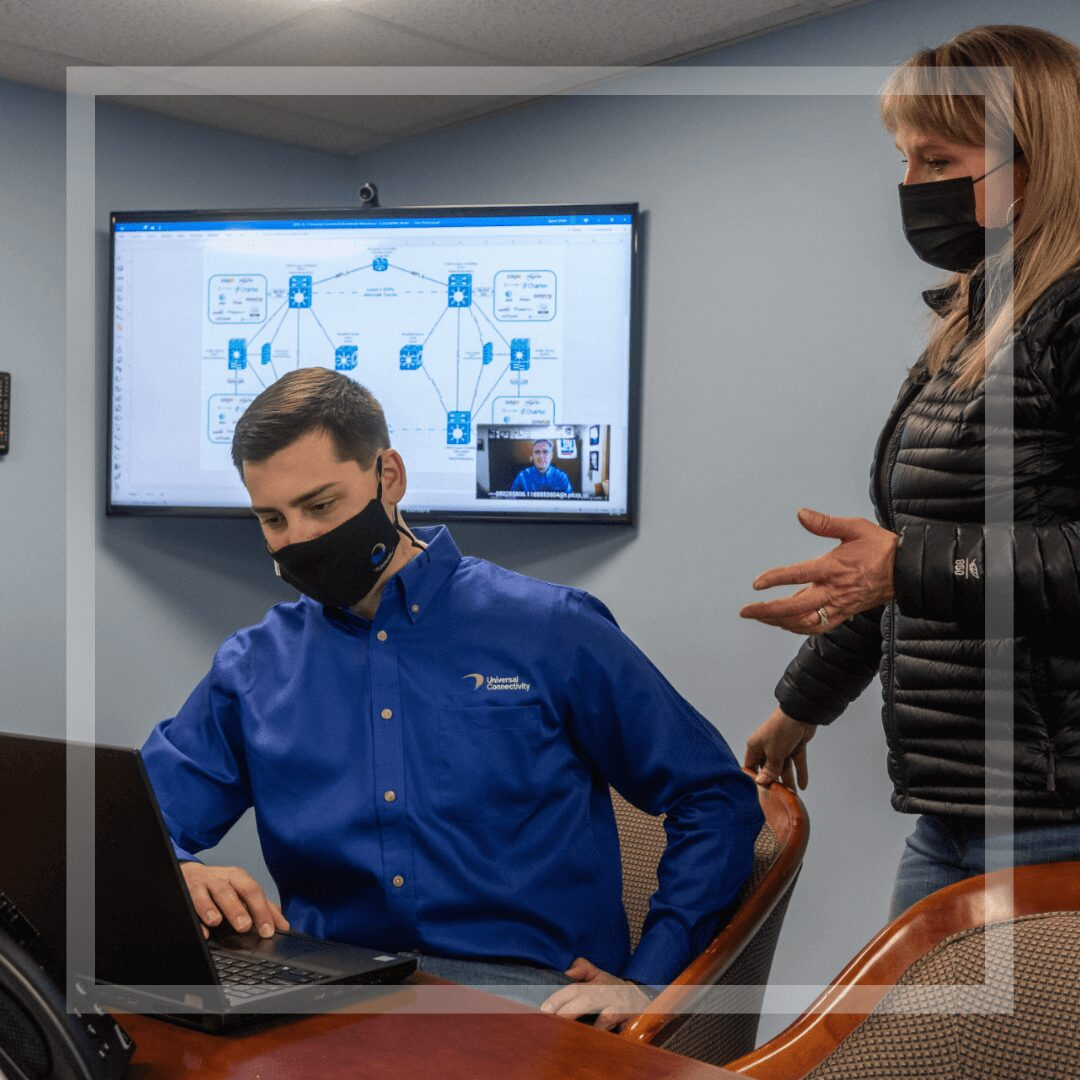 Team members in a conference room video call
